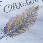 Oktober Monatstitel Glitzer-Feder